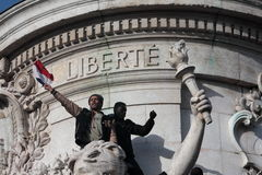 Black and arab people singing Marseillaise in Paris. Stock Images