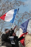 Black and arab people waving French flag in Paris. Stock Photography