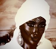 A Mysterious Black Arab Woman from the Saharan sands. Black Arab Woman from the Saharan sands.  A mysterious beauty wearing a white headscarf and robe with Royalty Free Stock Photography