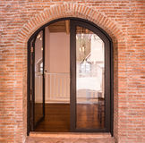 Black arch door on red brick wall Royalty Free Stock Photography