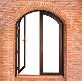 Black arch door on red brick wall Stock Images