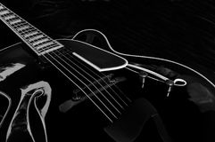 Black Archtop Guitar - 01 Royalty Free Stock Photo