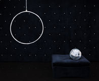 The black area in style feshion with glossy floor. The black area with crystals style feshion with black glossy floor, disco ball, black pouf, hanging ring royalty free stock photo