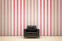 Black armchair. Black chair in a room with striped wallpaper Stock Photo