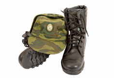 Black Army boots and cap. On white background Royalty Free Stock Images