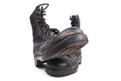 Black Army Boots. Pair of Black Dirty army boots isolated on white background Royalty Free Stock Photos
