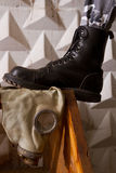 Black army boots standing on gas mask Royalty Free Stock Photography