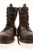 Black army/military boots on white background Royalty Free Stock Photo