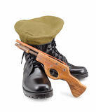Black army shoes,Beret,gun  on white backgrounds Stock Image