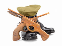 Black army shoes,Beret,gun  on white backgrounds Royalty Free Stock Image