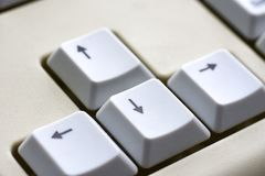 Black arrow on white buttons of a white keyboard close-up. Black arrow on white buttons of  white keyboard close-up Stock Photography