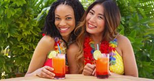Black and Asian best friends enjoying tropical vacation together Royalty Free Stock Photos