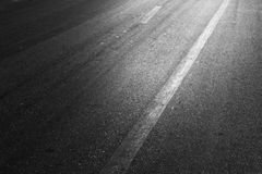 Black asphalt road on light. Stock Photos