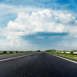Black asphalt road and low clouds Stock Photography