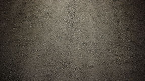 Black asphalt with vignette for background or texture Royalty Free Stock Photo