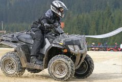 Black ATV. ATV racer in black after a fast left turn Royalty Free Stock Images