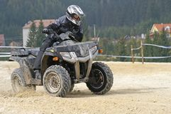 Black ATV turn. ATV racer taking a left turn Royalty Free Stock Images