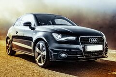 Black Audi Coupe on Brown Road Royalty Free Stock Images