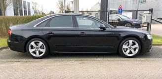 Black Audi A8. Naarden, The Netherlands - March 11, 2017 Black Audi A8 parked by the side of the road. Nobody in the vehicle Stock Images