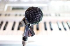 Black audio microphone on rack closeup royalty free stock images