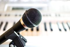 Black audio microphone on rack closeup royalty free stock photos
