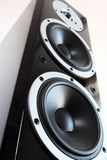 Black audio speakers tower. Black high gloss music speakers isolated on white background Stock Photography