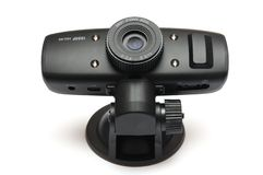 A black automobile car front or rear video dash cam. A front facing photo taken on a black automobile car front or rear video dash cam against a white backdrop stock images