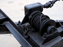 Black automotive winch on tow trailer. stock photos