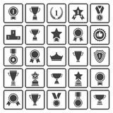 Black avards  icons set. Big set of  black vector award success and victory icons with trophies,stars,cups,ribbons,rosettes,medals,medallions ,wreath, podium Stock Images