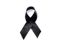 Black awareness ribbon.Mourning and melanoma symbol. Royalty Free Stock Photos