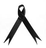 Black awareness ribbon on white background. Stock Photo