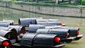 Black awning boats. With red lanterns on a river in Shaoxing city,China royalty free stock photography