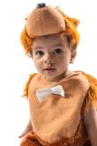 Black baby boy,dressed in furry teddy bear carnival suit  isolated on white . Royalty Free Stock Photography