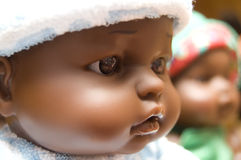 Black baby doll face Stock Image