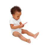 Black baby playing with mobile phone. Stock Images
