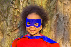 Black baby in super hero costume. The winner and success concept royalty free stock photography