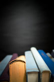 Black background with books Royalty Free Stock Image