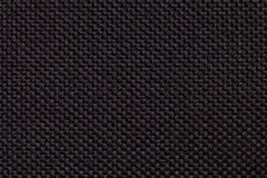 Black background with braided checkered pattern, closeup. Texture of the weaving fabric, macro.  Royalty Free Stock Images
