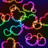 Black background with bright color hearts. Black background with bright color neon hearts (seamless background Stock Images
