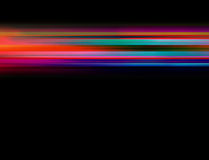 Black background with bright neon coloured lines in middle Royalty Free Stock Images