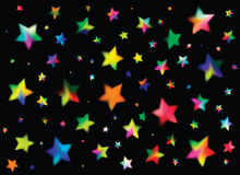 Black background with colored stars Stock Image