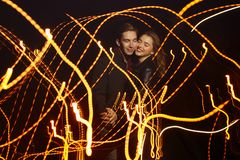 Black background, couple dancing in light, dance of light, music of light, holiday stock images