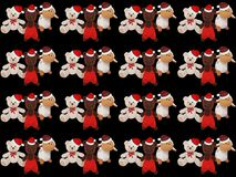 Black background with cute Christmas teddy bears and a sheep.  Stock Photo