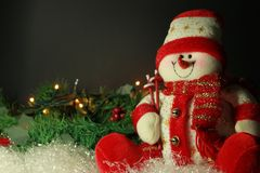 Christmas background with snowman and lights on pine wreath, sui stock photos