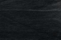 Black background, denim jeans background. Jeans texture, fabric. Royalty Free Stock Images