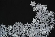 Background with snowflakes. Black background with different knitted snowflakes royalty free stock photography