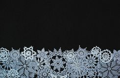 Background with snowflakes. Black background with different knitted snowflakes royalty free stock image