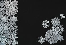 Background with snowflakes. Black background with different knitted snowflakes stock photos