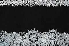 Background with snowflakes. Black background with different knitted snowflakes stock images
