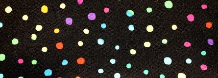 Black background with dots. Black background with many colored dots royalty free stock photo